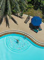 Aerial view of a 5 star Hotel swimming pool in Bangkok, with swimmer and heart shape water ripples
