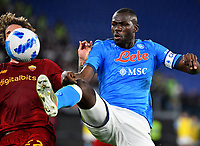 Calcio, Serie A: AS Roma vs SSC Napoli, Olympic stadium, October 24, 2021.<br /> Napoli's captain Kalidou Koulibaly (R) in action with Roma's Nicolo' Zaniolo (L) during the Italian Serie A football match between Roma and Napoli at Rome's Olympic stadium, on , October 24, 2021. <br /> UPDATE IMAGES PRESS/Isabella Bonotto