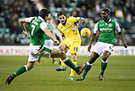 Hibs v St Johnstone…18.11.17…  Easter Road…  SPFL<br />Paul Paton is closed down by  John McGinn and Marvin Bartley<br />Picture by Graeme Hart. <br />Copyright Perthshire Picture Agency<br />Tel: 01738 623350  Mobile: 07990 594431