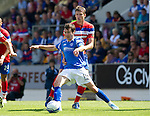 St Johnstone v Rangers... 30.07.11   SPL Week 2.Carl Finnigan holds off Dorin Goian.Picture by Graeme Hart..Copyright Perthshire Picture Agency.Tel: 01738 623350  Mobile: 07990 594431
