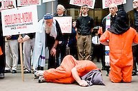 Demonstrators dress up in prisoner clothing during a protest in New York City on May 1, 2006 for those tortured and unjustly imprisoned at Guantanamo Bay.<br /> <br /> The protest was organized by various religious leaders and marched from the Isaiah Wall near United Nations headquarters to the US Mission to the United Nations.
