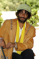 "GIOVANNI MARTORANA.Photcall for the film ""Io, l'altro"", Campidoglio, Rome, Italy..May 10th, 2007.half length brown beige leather jacket yellow scarf green hat beard facial hair .CAP/CAV.©Luca Cavallari/Capital Pictures"