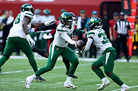 10th October 2021; Tottenham Hotspur stadium, London, England; NFL UK Series, Atlanta Falcons versus New York Jets: New York Jets Quarterback Zach Wilson (2) hands off to Adrian Colbert (33)