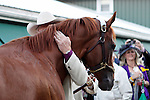 May 17, 2014. Back at the barn post-race, co-owner Steve Coburn hugs California Chrome, who won the 139th Preakness Stakes at Pimlico Race Course in Baltimore, MD. ©Joan Fairman Kanes/ESW/CSM