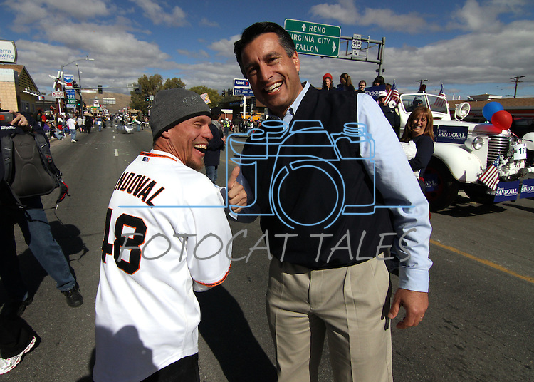Kevin Folds, of Carson City, shows off his San Francisco Giants jersy to gubernatorial candiate Brian Sandoval during Saturday's Nevada Day parade, in Carson City, Nev. .Photo by Cathleen Allison