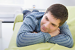 Russia, Voronezh, Young man resting on bed