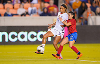 HOUSTON, TX - FEBRUARY 03: Jessica McDonald #14 of the United States moves with the ball past Gabriela Guillen #2 of Costa Rica during a game between Costa Rica and USWNT at BBVA Stadium on February 03, 2020 in Houston, Texas.