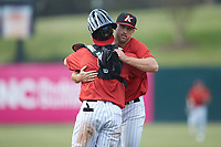 Kannapolis Intimidators relief pitcher Michael Hickman (13) is congratulated by catcher Evan Skoug (9) after closing out the game against the Rome Braves at Kannapolis Intimidators Stadium on April 7, 2019 in Kannapolis, North Carolina. The Intimidators defeated the Braves 2-1. (Brian Westerholt/Four Seam Images)