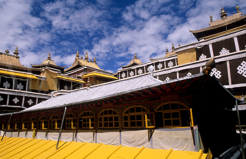 Wonderful Potala Palace inside with steeples at the home of the Dalai Lama with lake in capital city of Lhasa Tibet China