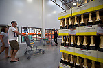 Costco Wholesale Corp. members pass store brand Champagne at a newly opened Costco warehouse in Villebon-Sur-Yvette, France, on Saturday, July 7, 2018. The 150,000-square foot warehouse, which opened last month just outside of Paris, is Costco's first store in France. Costco plans to open 15 more warehouses in France by 2025. Photograph by Michael Nagle