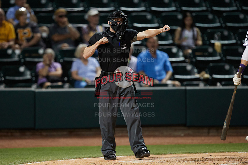Home plate umpire Edwin Jimenez calls a batter out on strikes during the game between the Greensboro Grasshoppers and the Winston-Salem Dash at Truist Stadium on June 15, 2021 in Winston-Salem, North Carolina. (Brian Westerholt/Four Seam Images)