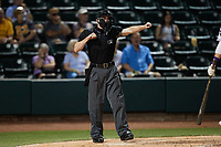 Home plate umpire Dylan Bradley calls a batter out on strikes during the game between the Greensboro Grasshoppers and the Winston-Salem Dash at Truist Stadium on June 15, 2021 in Winston-Salem, North Carolina. (Brian Westerholt/Four Seam Images)