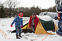 """28/03/16 <br /> <br /> Chris McCoy and son Joe McCoy (4) wake to a snow-covered tent.<br /> <br /> Holiday makers camping in the Derbyshire Peak District woke up to an unexpected white blanket this morning, thanks to Storm Katie.<br /> The covering of snow meant that many campers cut short their plans for a long weekend away, to brave the icy roads and head home early on Monday morning.<br /> But it wasn't all bad news for some of the younger guests at Grin Low Caravan Site in Buxton.<br /> Three-year-old Greta Williams made the most of the morning's surprise by building a snowman and enjoying snowball fights with her aunt Claire Jones. <br /> Claire said it was the first time she had been camping in the snow. <br /> """"It was completely unexpected but it's made it a trip to remember,""""she said. <br /> """"Greta really enjoyed making the snowman, but I think we'll head back home now in case any more falls.""""<br /> For Chris and Lorraine McCoy the first they knew of the snow was when they woke up and stuck their heads out of their tent.<br /> They had travelled to Buxton from Warwickshire with their four-year-old son Joe, to enjoy a weekend break.<br /> """"It's all part of the adventure,"""" said Chris. """"It's a bit cold in the tent but we'll soon warm up, and it's made the surrounding countryside really beautiful.""""<br /> <br /> All Rights Reserved: F Stop Press Ltd. +44(0)1335 418365   +44 (0)7765 242650 www.fstoppress.com"""