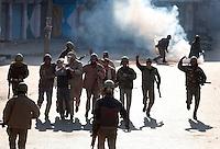Paramilitary police and  stone throwing youth clash following Friday prayer at the Jamia Masjid.  Srinagar, Kashmir, India. © Fredrik Naumann/Felix Features