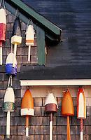 buoys decorating wall. Maine, coastal.