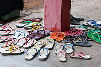 Myanmar, Burma.  Sandals, Flip-Flops, outside Entrance to a Buddhist Temple, Inle Lake, Shan State.
