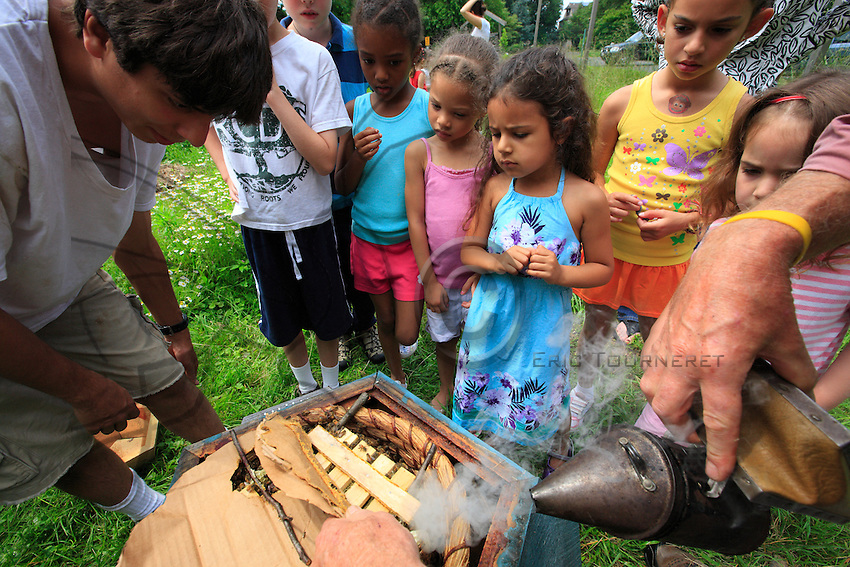 """Ron Breland, 64 years old, is a teacher at the private Rockland Country Day School of Congers, thirteen or so miles out of Manhattan. He set up the hives of his design in the school's organic garden and teaches apiculture to children from nursery to secondary school. """"It's extraordinary, just using my type of hive and smoking them with sage, I can open a hive without any danger to the kindergarten pupils. The bees raised like that are so much gentler and we practically never have any stings."""""""