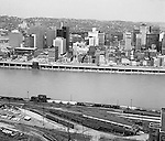 Pittsburgh PA:  View of the city's skyline.  The view includes Gateway Center and construction of the Pittsburgh Press Building.  View also includes the P&LERR railroad yard on the South Side and the many businesses along Fort Pitt Boulevard.