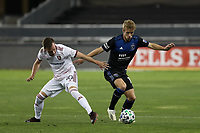 SAN JOSE, CA - OCTOBER 28: Jackson Yueill #14 of the San Jose Earthquakes battles for the ball with Corey Baird #10 of Real Salt Lake during a game between Real Salt Lake and San Jose Earthquakes at Earthquakes Stadium on October 28, 2020 in San Jose, California.