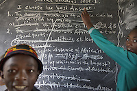 Ethiopia. Southern Nations, Nationalities, and Peoples' Region. Omo Valley. Hayzo Village. High altitude: 2800 meters. Dorze tribe. A boy and a girl stand near the blackboard of a public school's classroom. The Dorze are a small ethnic group inhabiting the Gamo Gofa Zone who speak the Dorze language, an Omotic tongue. The Dorze are predominantly agriculturalists living in permanent villages. The Dorze numbered 40'000 reside in villages near the cities of Chencha and Arba Minch. Southern Nations, Nationalities, and Peoples' Region (often abbreviated as SNNPR) is one of the nine ethnic divisions of Ethiopia. 6.11.15 © 2015 Didier Ruef
