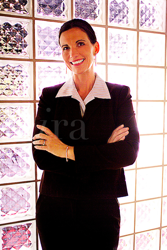 Successful business woman in business suit.