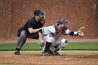 North Carolina Central Eagles catcher Conrad Kovalcik (17) sets a target as home plate umpire Lindy Hall looks on during the game against the High Point Panthers at Williard Stadium on February 28, 2017 in High Point, North Carolina. The Eagles defeated the Panthers 11-5. (Brian Westerholt/Four Seam Images)
