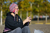 Carol Baker, of Cleveland, OH., knits Tuesday, October 13, 2020, as she sits near the shoreline of Lake Fayetteville. Baker was knitting hot pads and was in town to visit friends and spend some time hiking on the Ozark Highlands Trail. Check out nwaonline.com/201014Daily/ and nwadg.com/photos for a photo gallery.(NWA Democrat-Gazette/David Gottschalk)