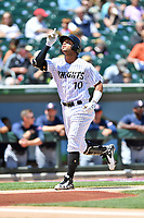 Charlotte Knights second baseman Yoan Moncada (10) celebrates home run during a game against the  Gwinnett Braves at BB&T Ballpark on May 7, 2017 in Charlotte, North Carolina. The Knights defeated the Braves 7-1. (Tony Farlow/Four Seam Images)