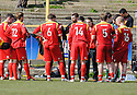 Albion Rovers boss Paul Martin gives his team talk before they head into extra time....