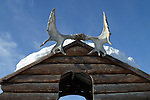 A pair of antlers decorate the playhouse on top of a slide in a children's playground in Old Crow, Yukon Territory, Canada.