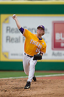 LSU Tigers pitcher Austin Bain (18) warms up before the Southeastern Conference baseball game against the Texas A&M Aggies on April 25, 2015 at Alex Box Stadium in Baton Rouge, Louisiana. Texas A&M defeated LSU 6-2. (Andrew Woolley/Four Seam Images)