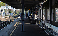 A handful of commuters at the rail station in Sidcup, Kent during the Coronavirus (COVID-19) outbreak where travel has been restricted across the country at Sidcup, England on 25 March 2020. Photo by Alan Stanford/PRiME Media Images