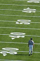 University of California vs UCLA. A referee walks the field pre-game.
