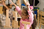 Education preschool 4 year olds block area boy and girl building together with wooded blocks  excited about blocks staying balanced horizontal