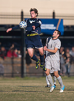 James Cohn (6) of San Diego takes control of the ball in front of Tommy Muller (8) of Georgetown during the game at North Kehoe Field in Washington, DC.  Georgetown defeated San Diego, 3-1.