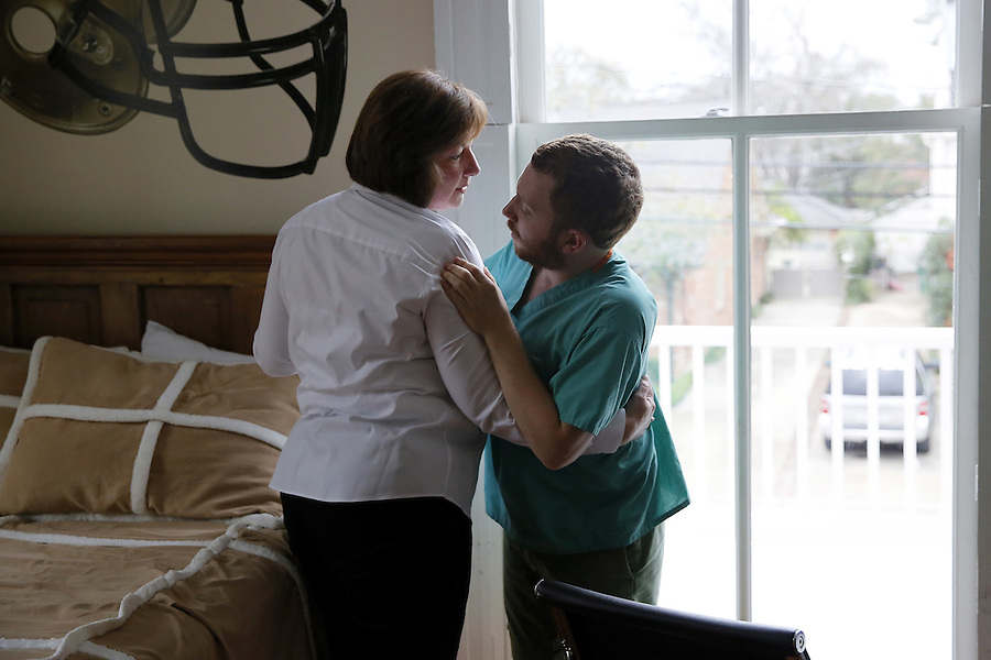 """PLEASE HOLD FOR MARTHA IRVINE STORY: In this Wednesday, March 2, 2016 photo, Judy Nodurft, the former head of special education in Ben's old school district, talks to Ben Alexander at his house in Metairie, La. Alexander, 22, has nonverbal autism, a condition that became apparent when he was 2 years old. He has found his voice through writing using what is known as """"facilitated communication,"""" a method in which another person steadies the hand of the autistic person, so he or she can communicate through typing. (AP Photo/Jonathan Bachman)"""