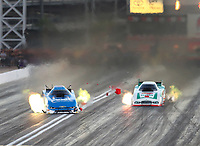 Oct 27, 2017; Las Vegas, NV, USA; NHRA funny car driver John Force (left) crosses the centerline alongside Jim Campbell during qualifying for the Toyota National at The Strip at Las Vegas Motor Speedway. Mandatory Credit: Mark J. Rebilas-USA TODAY Sports