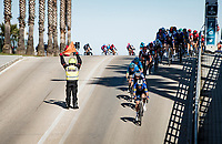road safety marchal can be risky business...<br /> <br /> Stage 6 from Castelraimondo to Lido di Fermo (169km)<br /> <br /> 56th Tirreno-Adriatico 2021 (2.UWT) <br /> <br /> ©kramon
