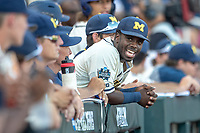 Michigan Wolverines second baseman Ako Thomas (4) in the dugout before Game 1 of the NCAA College World Series Finals on June 24, 2019 at TD Ameritrade Park in Omaha, Nebraska. Michigan defeated Vanderbilt 7-4. (Andrew Woolley/Four Seam Images)
