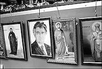 Icons in the open-air market. The second from the left is Radovan Karadzic. Karadzic is the former ruler of the Serbian Republic in Bosnia-Herzegovina, as well as the number one wanted war criminal from the civil war in ex-Yugoslavia. New Blegrade, Serbia, Yugoslavia February 2001 © Stephen Blake Farrington<br />