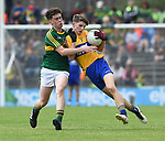 Colin Mc Neilis of Clare in action against Jack Griffin of Kerry during their Minor Munster final at Killarney.  Photograph by John Kelly.