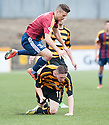 Alloa's Declan McManus goes in late on Livy's Jason Talbot.