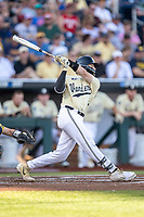 Vanderbilt Commodores catcher Phillip Clarke (5) swings the bat against the Michigan Wolverines during Game 3 of the NCAA College World Series Finals on June 26, 2019 at TD Ameritrade Park in Omaha, Nebraska. Vanderbilt defeated Michigan 8-2 to win the National Championship. (Andrew Woolley/Four Seam Images)