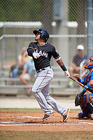 Miami Marlins third baseman Rony Cabrera (68) follows through on a swing during a minor league Spring Training game against the New York Mets on March 26, 2017 at the Roger Dean Stadium Complex in Jupiter, Florida.  (Mike Janes/Four Seam Images)