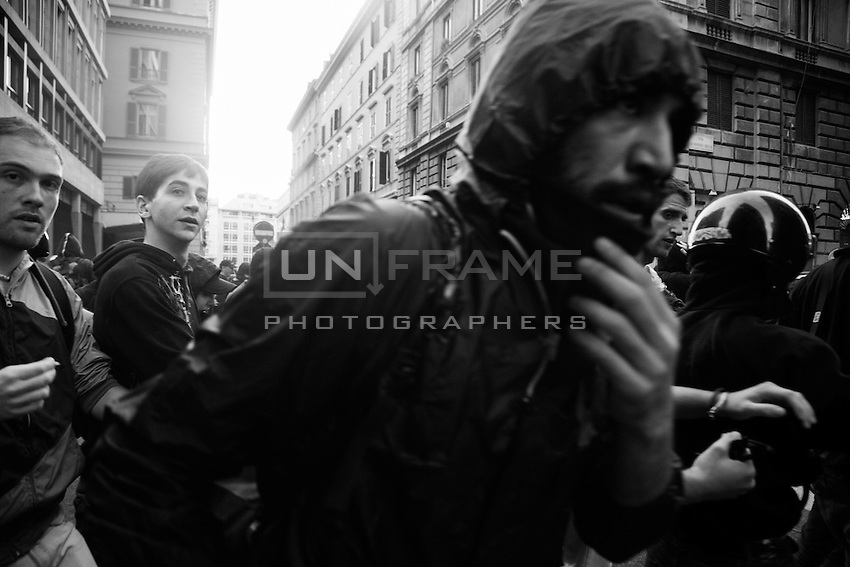 Protesters escape a riot police assault after the entrance of the Ministry of Economy has been  attacked by a group of rioters, some of whom threw crude homemade explosive devices and others who took part in acts of vandalism. Rome, Italy. 19 October 2013