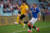 SYDNEY, AUSTRALIA - JULY 31, 2010: Blanco Ismael of AEK Athens is tackled by David Weir of Rangers during the match between AEK Athens FC and Glasgow Rangers at the 2010 Sydney Festival of Football held at the Sydney Football Stadium on July 31, 2010 in Sydney, Australia. (Photo by Sydney Low / www.syd-low.com)