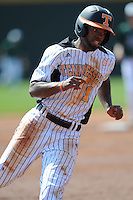 Andrew Toles #1 of the Tennessee Volunteers rounds third at Lindsey Nelson Stadium against the the Manhattan Jaspers on March 12, 2011 in Knoxville, Tennessee.  Tennessee won the first game of the double header 11-5.  Photo by Tony Farlow / Four Seam Images..