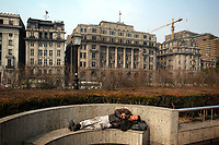 CHINA. Shanghai. A homeless man sleeping on the Bund. Shanghai is a sprawling metropolis or 15 million people situated in south-east China. It is regarded as the country's showcase in development and modernity in modern China. This rapid development and modernization, never seen before on such a scale has however spawned countless environmental and social problems. 2008