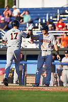 Aberdeen Ironbirds designated hitter Chris Shaw (17) high fives Alejandro Juvier (6) after hitting a home run during a game against the Batavia Muckdogs on July 14, 2016 at Dwyer Stadium in Batavia, New York.  Aberdeen defeated Batavia 8-2. (Mike Janes/Four Seam Images)
