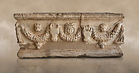 Roman relief sculpted garland sarcophagus, 3rd century AD. Adana Archaeology Museum, Turkey. Against a warm art background
